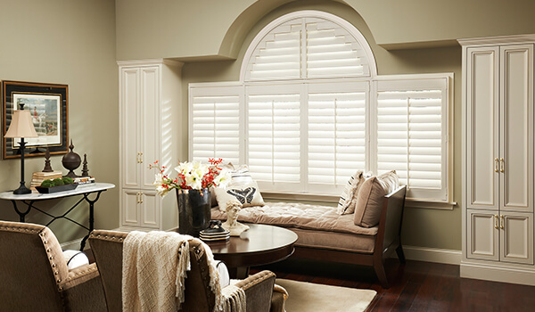 arched window shutters in living room