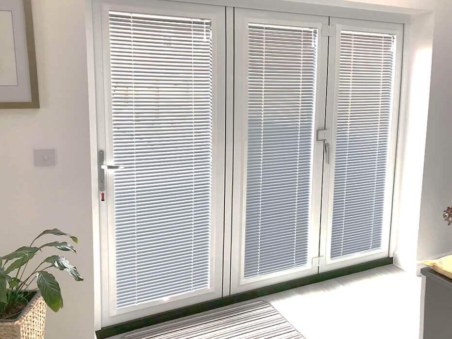 White venetian bi-fold door blinds