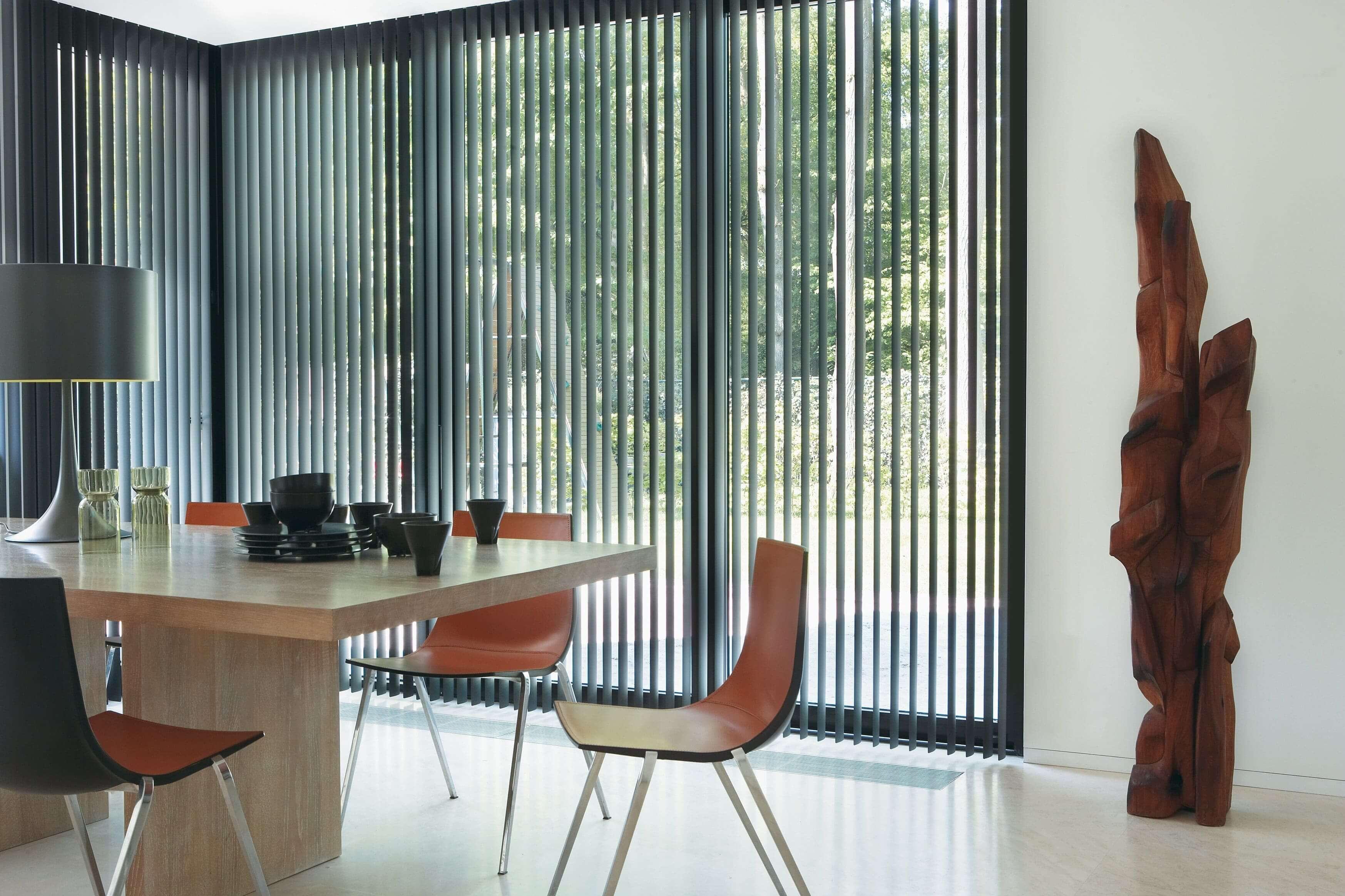 Black vertical patio door blinds in living room