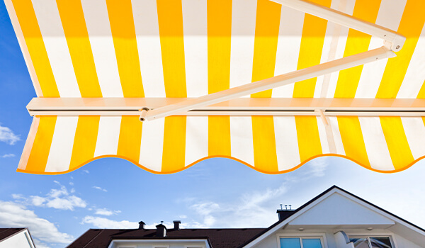 yellow and white striped canopy traditional shop awnings